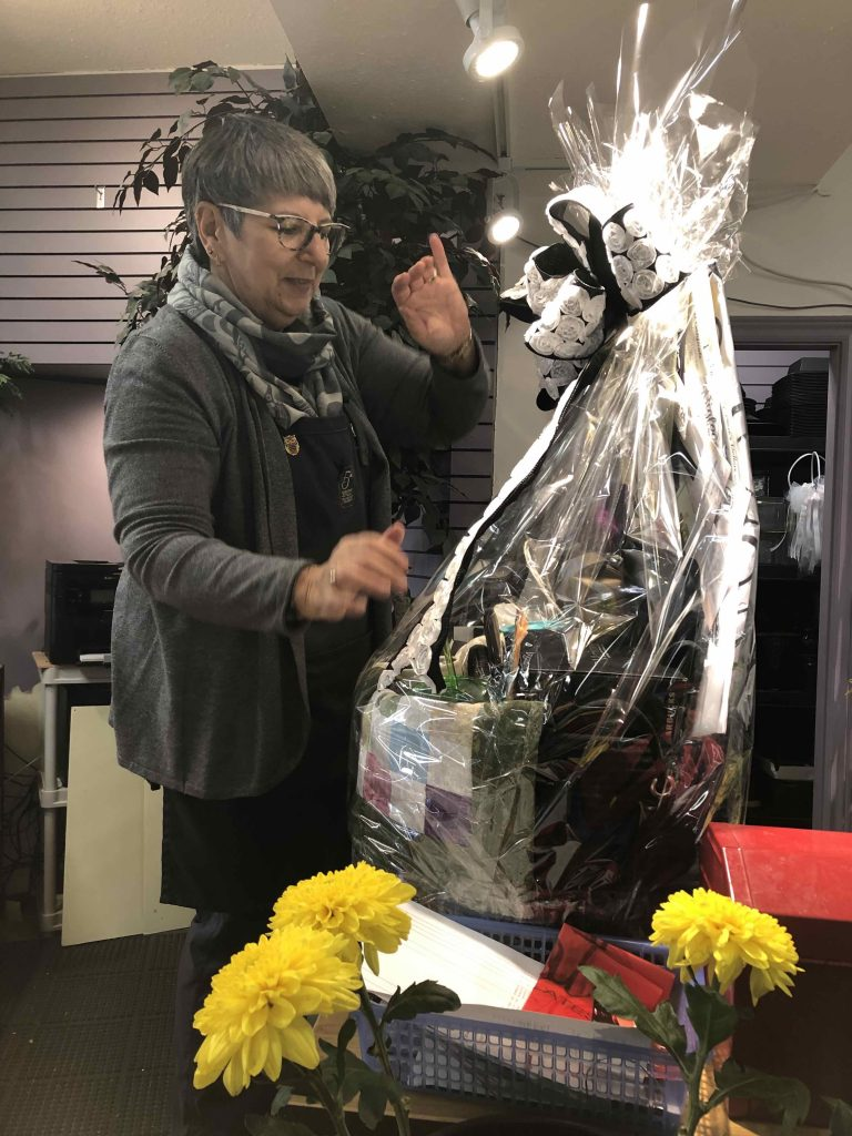 Deb from 5th Street Florists puts the final touches on CVCDA's 2019 Deluxe Raffle Basket.